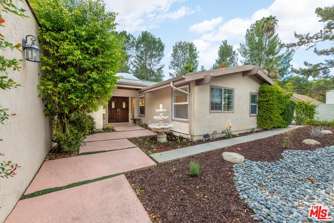 Photo of 19651 GREENBRIAR Drive, Tarzana, CA 91356 (MLS # 20556242)