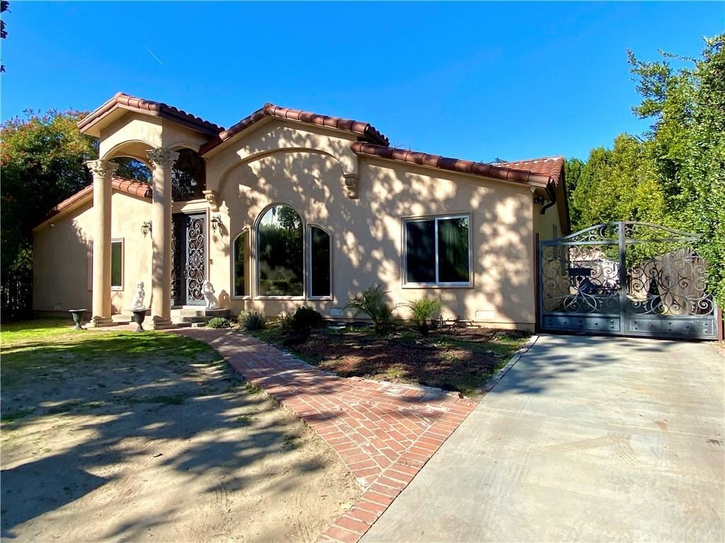 Photo of 12219 HUSTON Street, Valley Village, CA 91607 (MLS # SR20017242)
