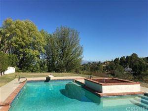 Photo of 5008 SANLO Place, Woodland Hills, CA 91364 (MLS # SR18112280)