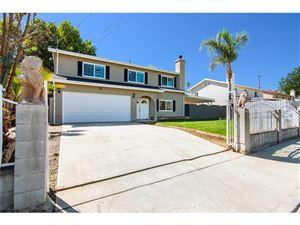 Photo of 21046 RUNNYMEDE Street, Canoga Park, CA 91303 (MLS # SR19057388)