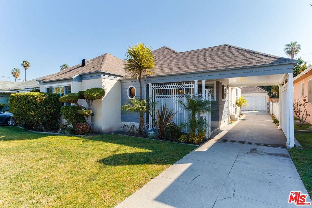 Photo of 3974 MCCLUNG Drive, Los Angeles , CA 90008 (MLS # 20548390)