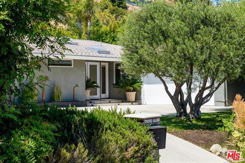 Photo of 9235 ROBIN Drive, Los Angeles , CA 90069 (MLS # 19523396)
