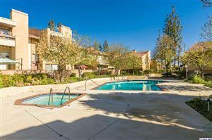 Photo of 10051 TOPANGA CANYON Boulevard #13, Chatsworth, CA 91311 (MLS # 319002396)