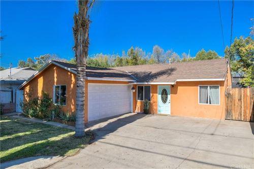 Photo of 21027 BASSETT Street, Canoga Park, CA 91303 (MLS # SR19275396)