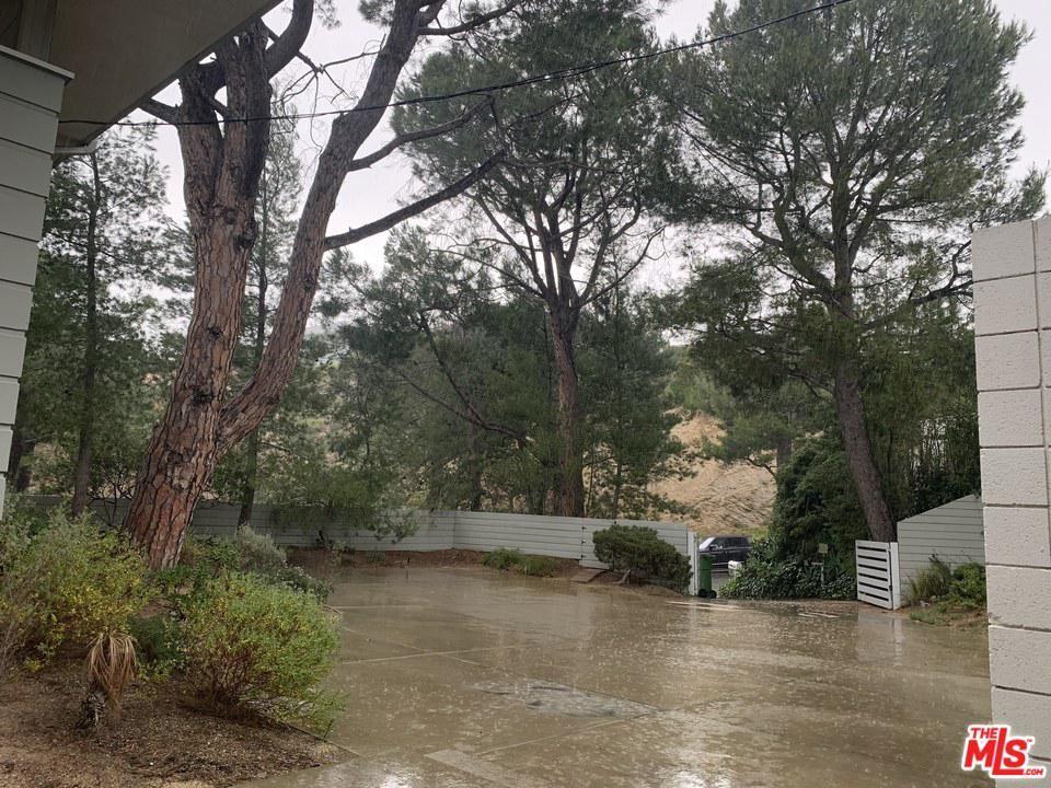 Photo of 1700 CARLA RIDGE Ridge, Beverly Hills, CA 90210 (MLS # 20552396)