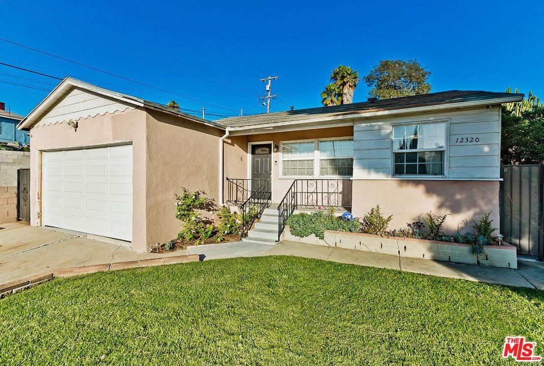Photo of 12320 MENLO Avenue, Los Angeles , CA 90044 (MLS # 20557398)