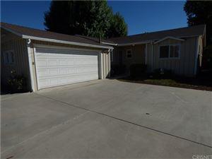 Photo of 22602 VICTORY Boulevard, Woodland Hills, CA 91367 (MLS # SR18255399)