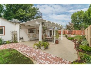 Photo of 8610 HAYVENHURST Avenue, North Hills, CA 91343 (MLS # SR18060485)