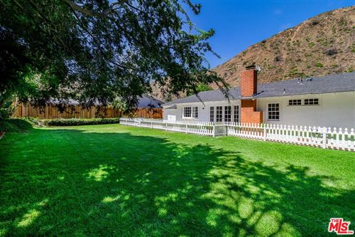 Photo of 5945 PASEO CANYON Drive, Malibu, CA 90265 (MLS # 20545502)