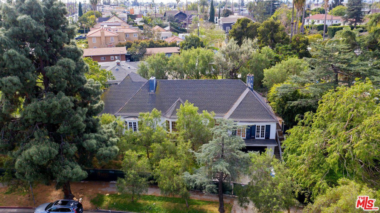 Photo of 3300 COUNTRY CLUB Drive, Los Angeles , CA 90019 (MLS # 20557570)