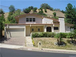Photo of 4501 GRIMES Place, Encino, CA 91316 (MLS # SR19178589)