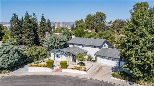 Photo of 20897 KELVIN Place, Woodland Hills, CA 91367 (MLS # SR19279591)