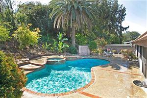 Photo of 5850 SERRANIA Avenue, Woodland Hills, CA 91367 (MLS # SR18175597)