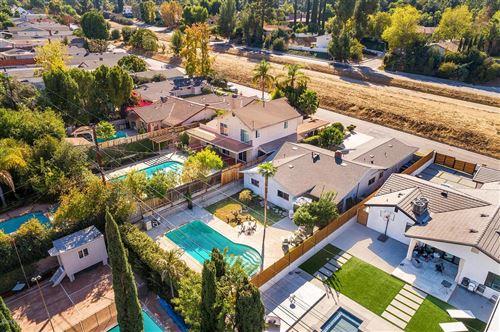 Photo of 21637 MULHOLLAND Drive, Woodland Hills, CA 91364 (MLS # 219013710)