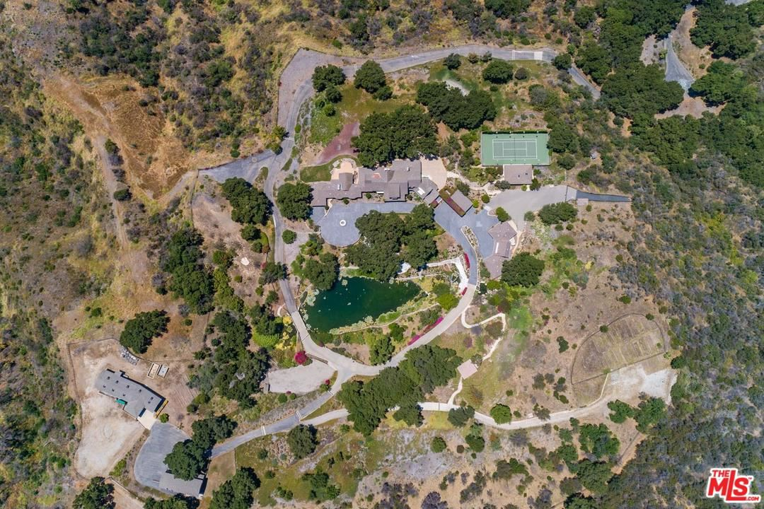 Photo of 3100 MANDEVILLE CANYON Road, Los Angeles , CA 90049 (MLS # 20557848)
