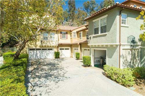 Photo of 23427 ABBEY GLEN Place, Valencia, CA 91354 (MLS # SR20064879)