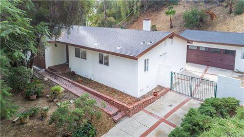 Photo of 8451 RUDNICK Avenue, West Hills, CA 91304 (MLS # SR19275943)