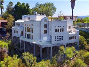 Photo of 5009 CERRILLOS Drive, Woodland Hills, CA 91364 (MLS # SR19185957)