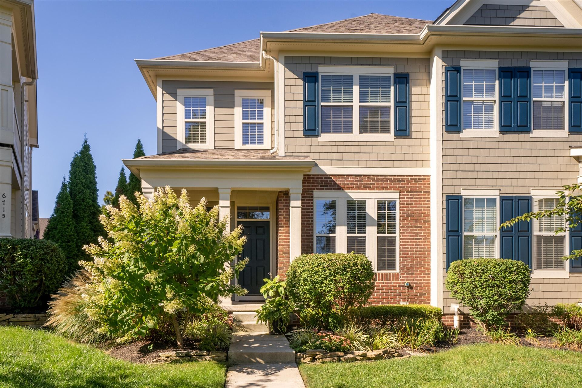 Photo of 6719 Cooperstone Drive #70, Dublin, OH 43017 (MLS # 221036090)