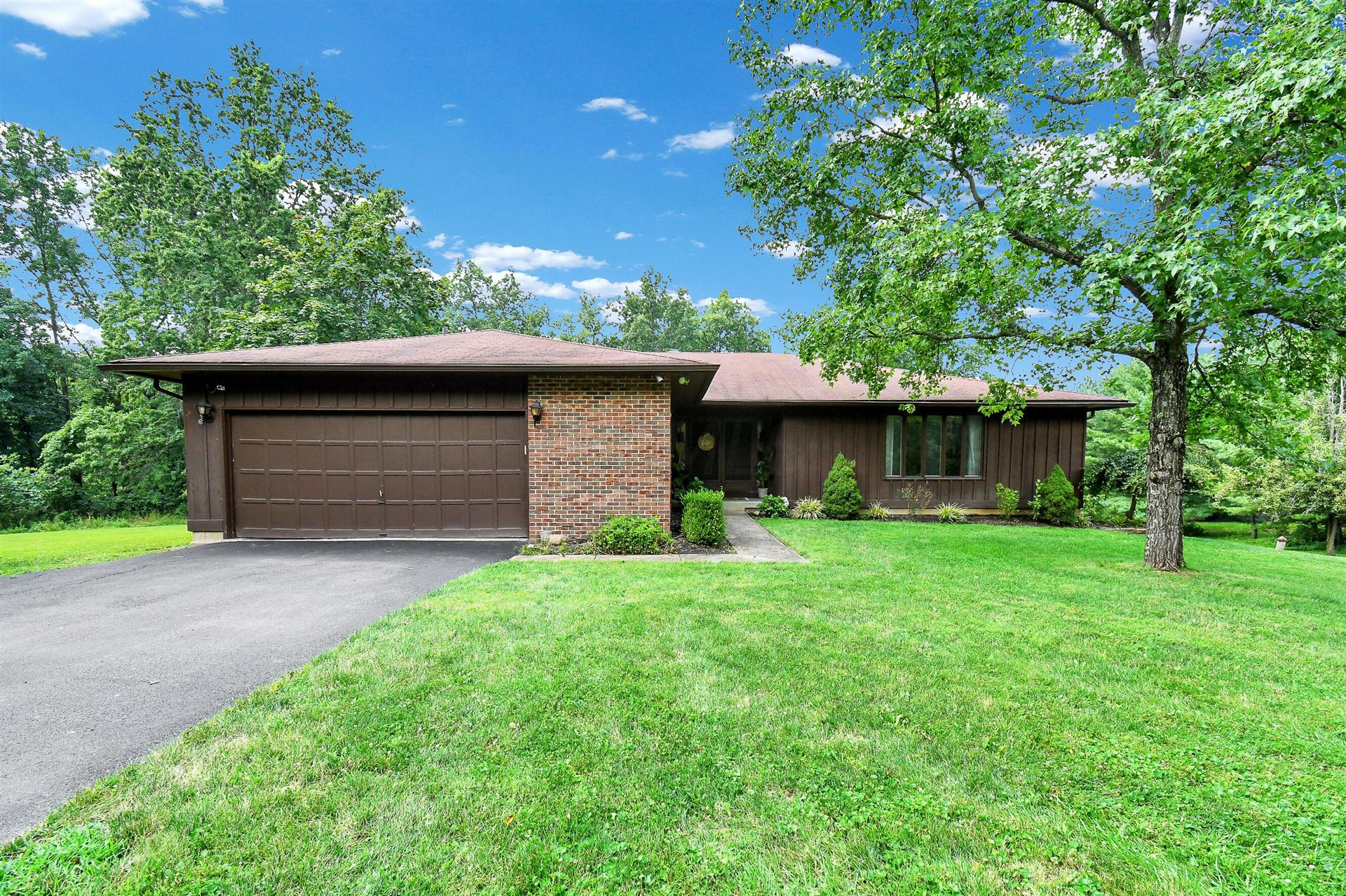 Photo of 8369 Manitou Drive, Westerville, OH 43081 (MLS # 221029097)