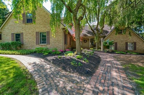 Photo of 7656 Cloister Drive, Columbus, OH 43235 (MLS # 221015308)