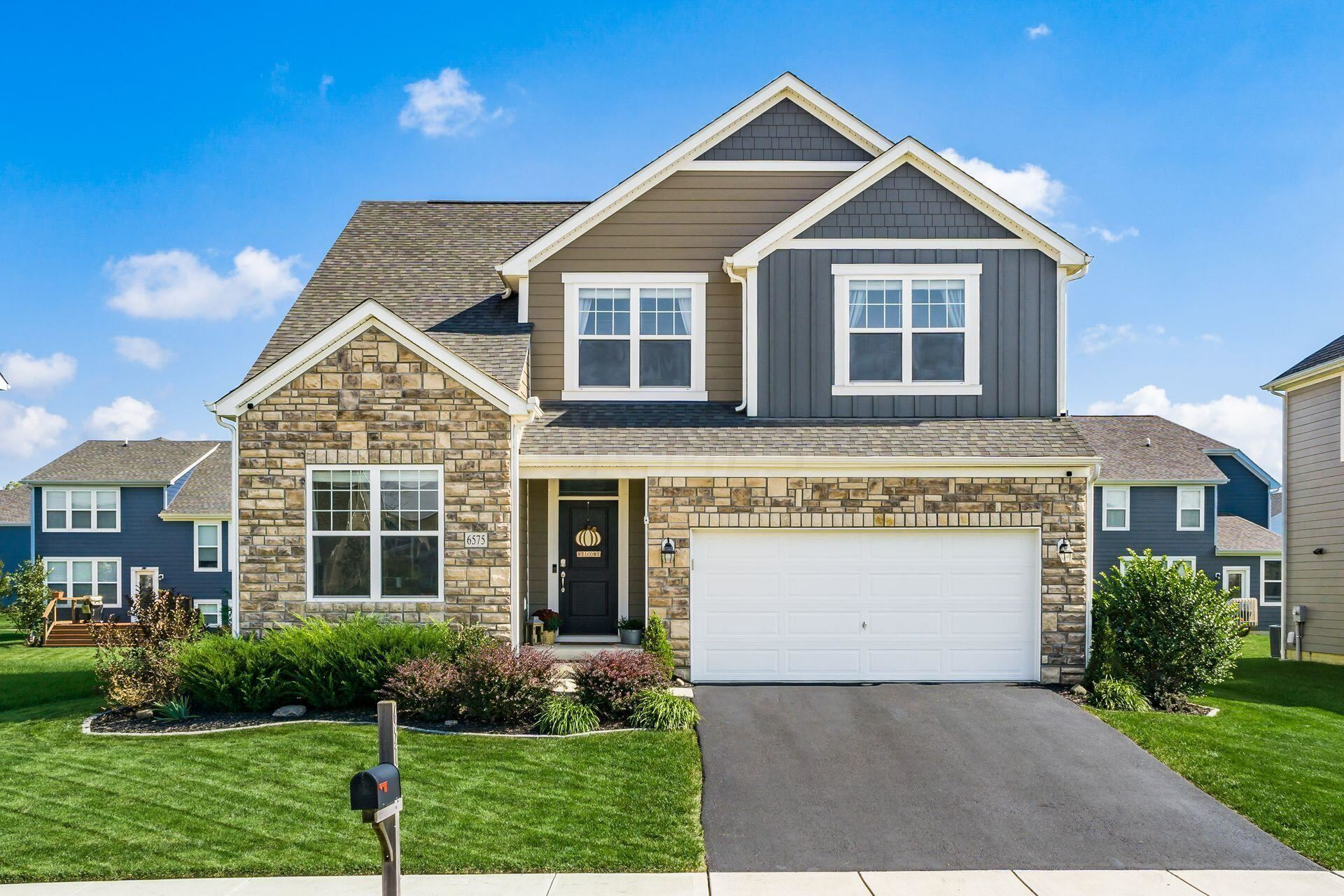 Photo of 6575 Valley Oak Drive, Powell, OH 43065 (MLS # 221040398)
