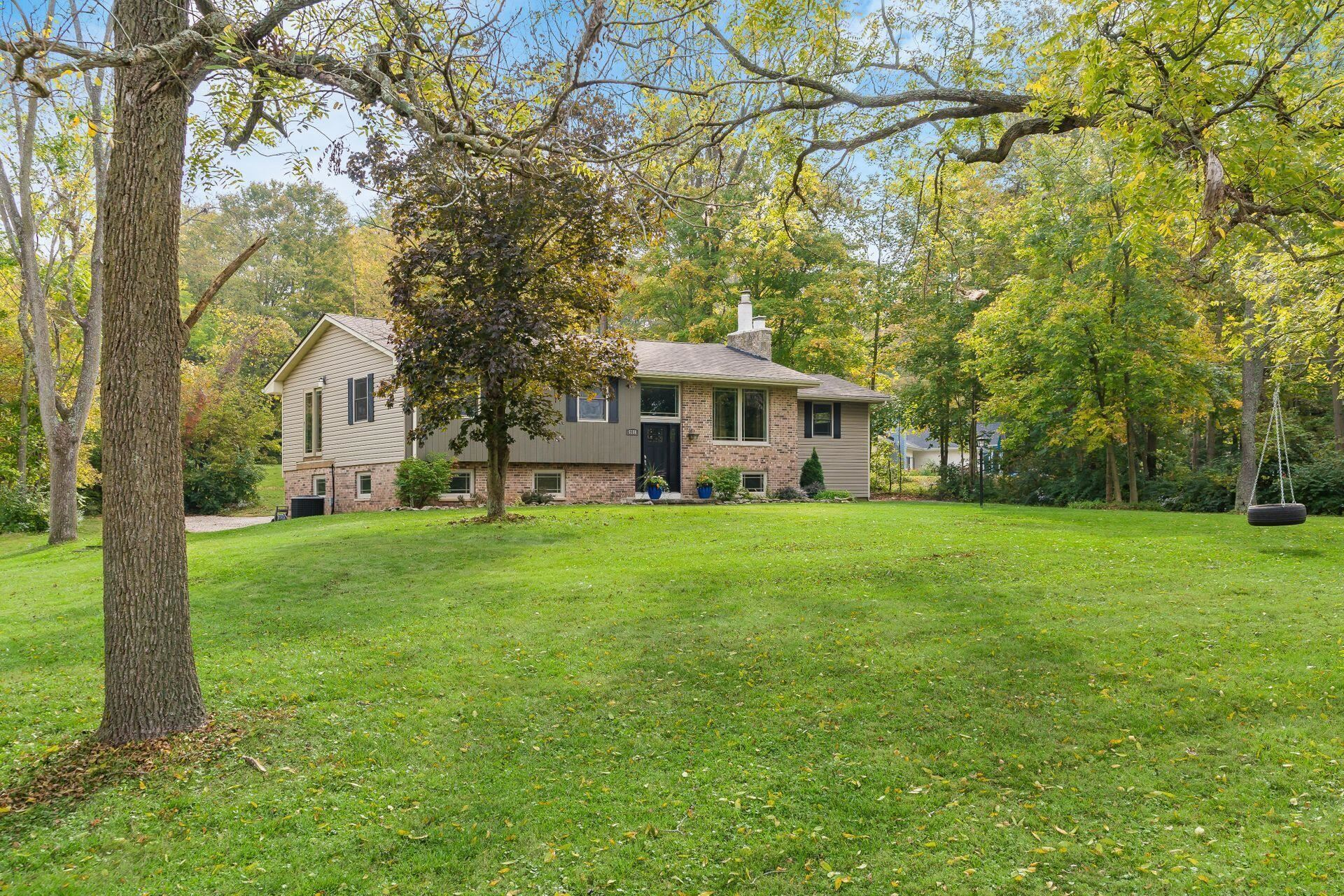 Photo of 6181 Riverside Drive, Powell, OH 43065 (MLS # 221039874)