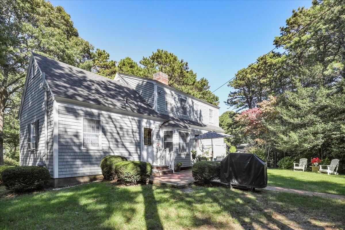 Photo of 154 Winding Cove Road, Marstons Mills, MA 02648 (MLS # 22106274)