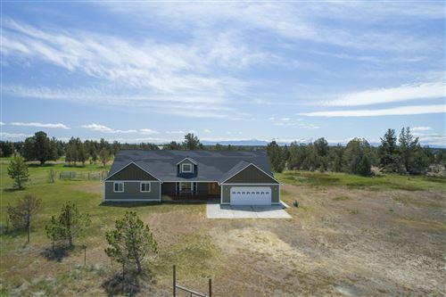 Photo of 414 SW Bent Loop, Powell Butte, OR 97753 (MLS # 220104169)