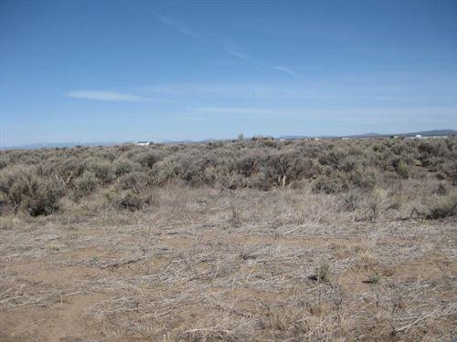Photo of TL 5700 Mountain  (27S17E18-C0-05700) Lane, Christmas Valley, OR 97641 (MLS # 220119900)