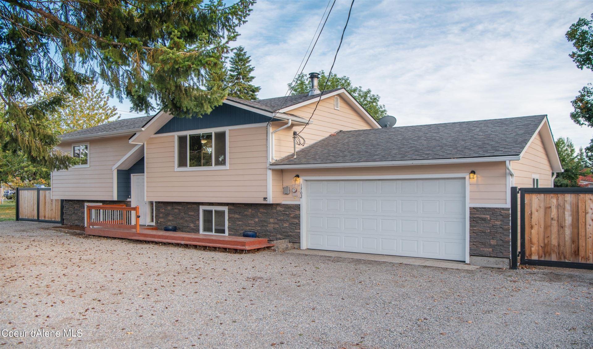 Photo of 1702 W Honeysuckle Ave, Hayden, ID 83835 (MLS # 21-10106)
