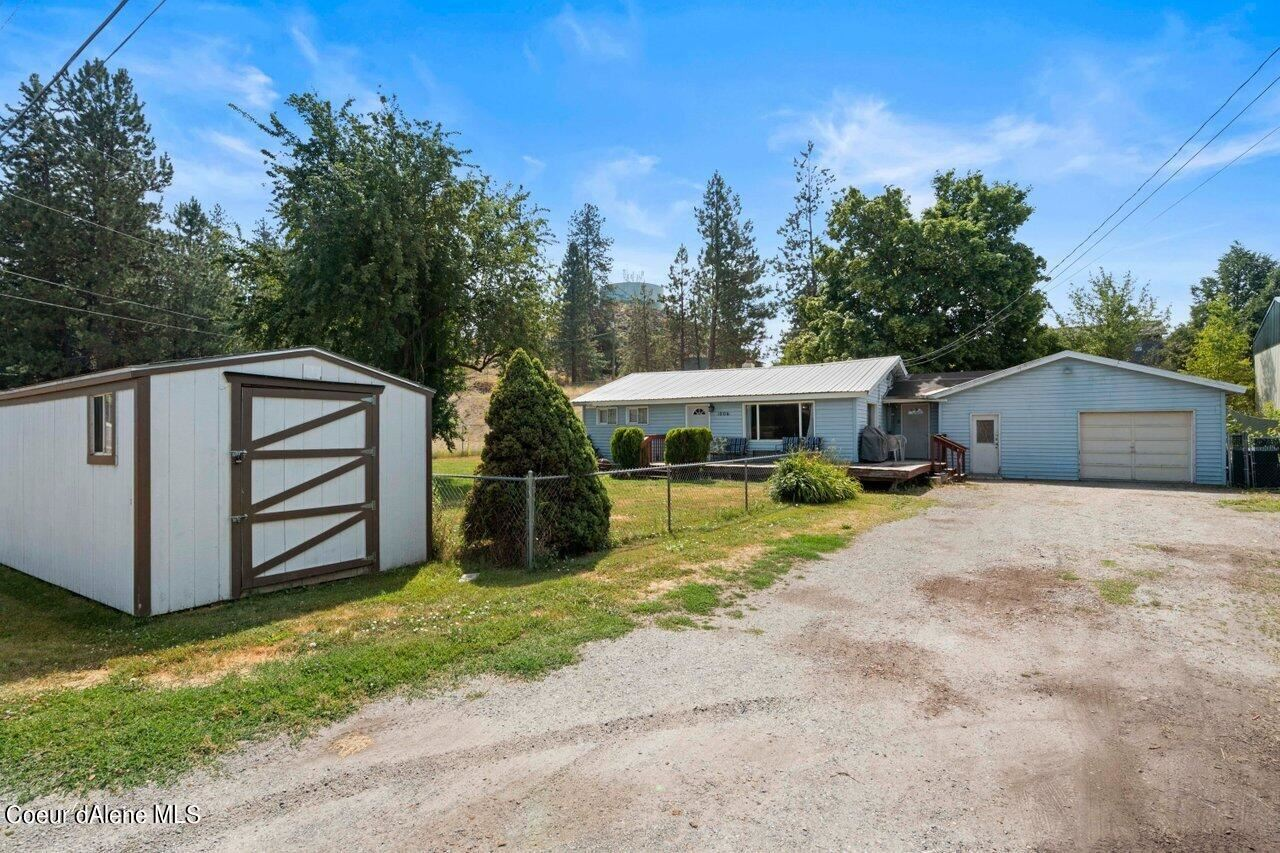 Photo of 1006 E 3RD AVE, Post Falls, ID 83854 (MLS # 21-10189)