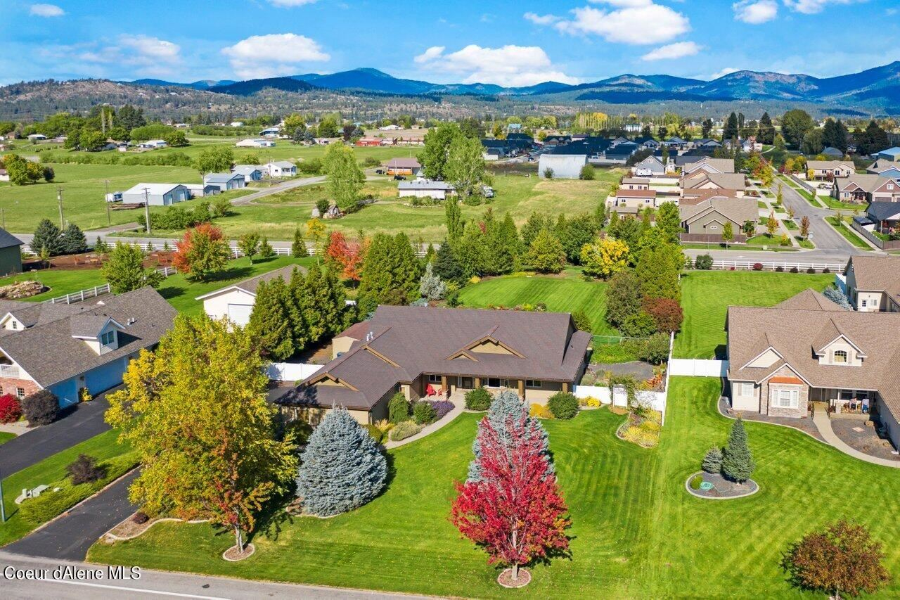 Photo of 1703 W POLO GREEN AVE, Post Falls, ID 83854 (MLS # 21-10217)