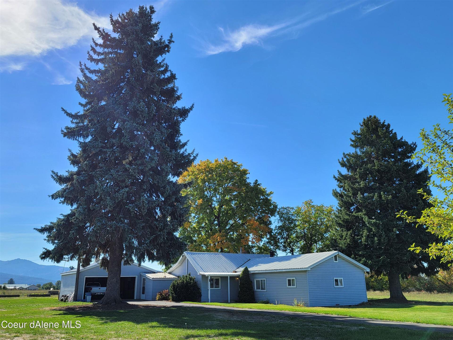 Photo of 14626 W Prairie Ave, Post Falls, ID 83854 (MLS # 21-10222)