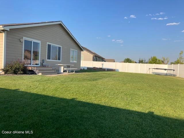 Photo of 1357 E WARM SPRINGS AVE, Post Falls, ID 83854 (MLS # 21-7265)