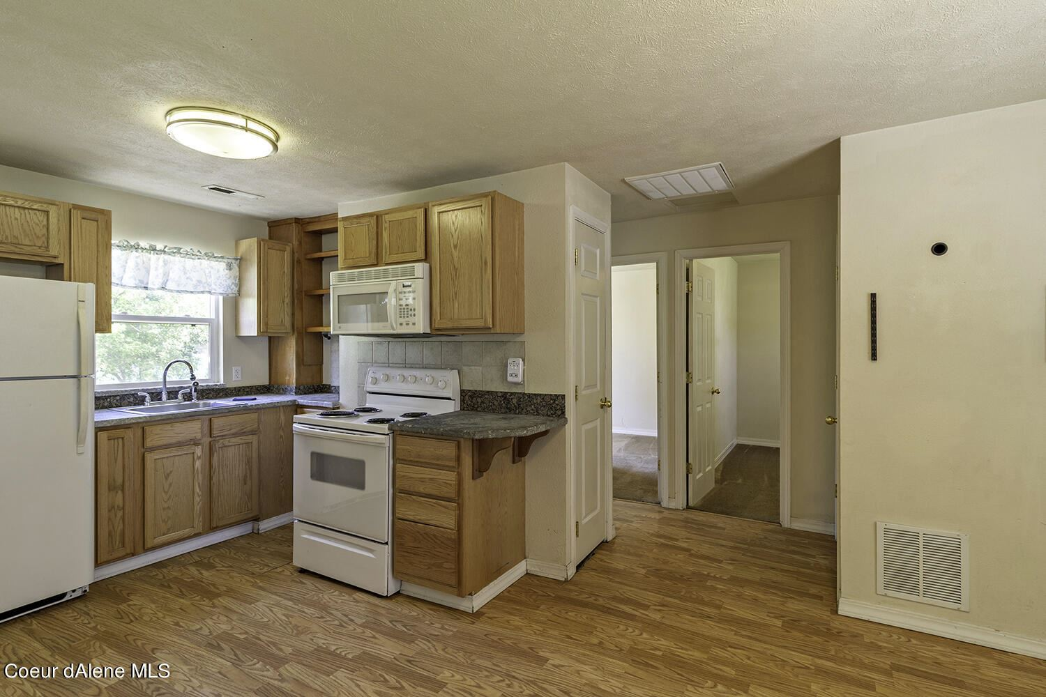 Photo of 209 W 22ND Ave, Post Falls, ID 83854 (MLS # 21-5303)