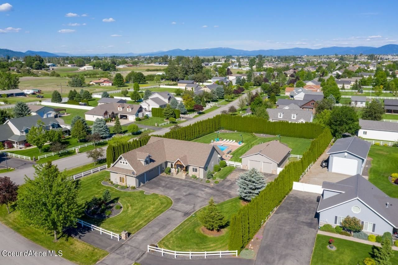 Photo of 2460 W POLO GREEN AVE, Post Falls, ID 83854 (MLS # 21-5306)