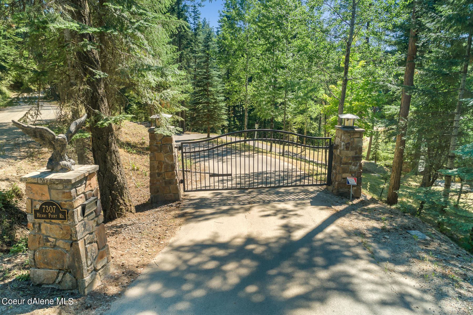 Photo of 7307 E Henry Point Rd, Hayden, ID 83835 (MLS # 21-7353)