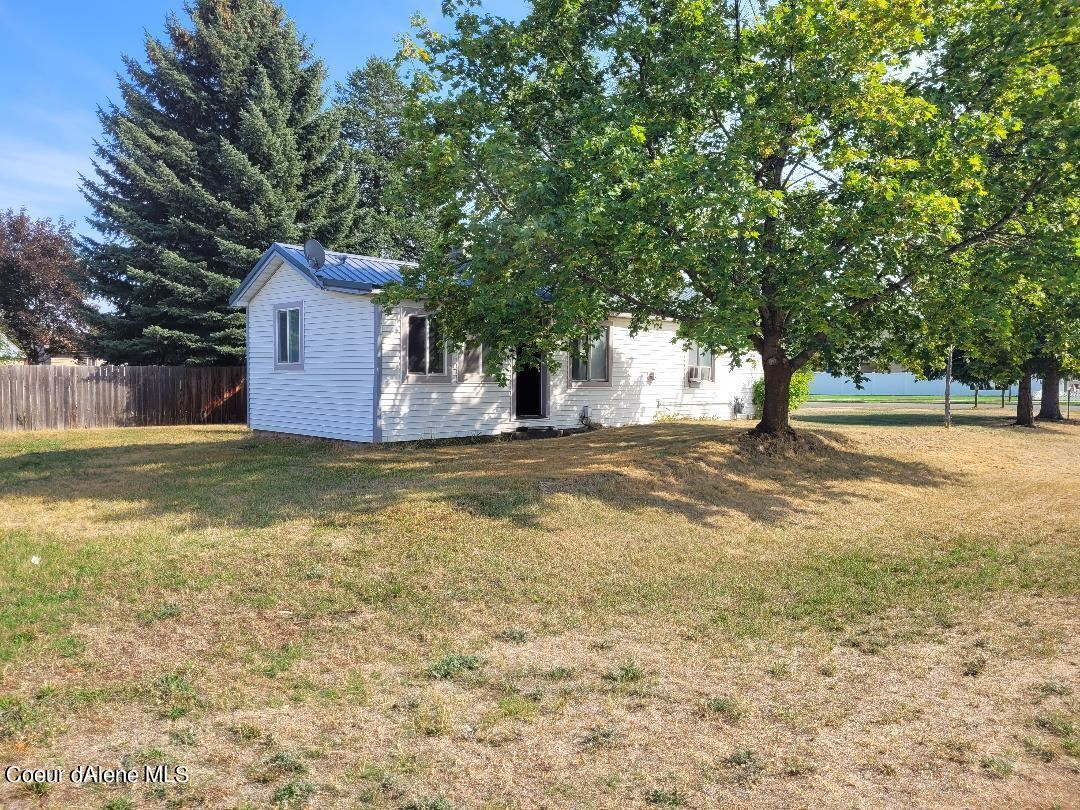 Photo of 601 E 2ND AVE, Post Falls, ID 83854 (MLS # 21-9363)
