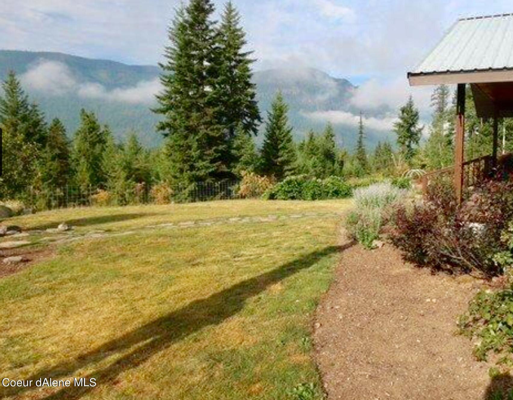 Photo of 230 Cougar Loop Rd, Clark Fork, ID 83811 (MLS # 21-1367)