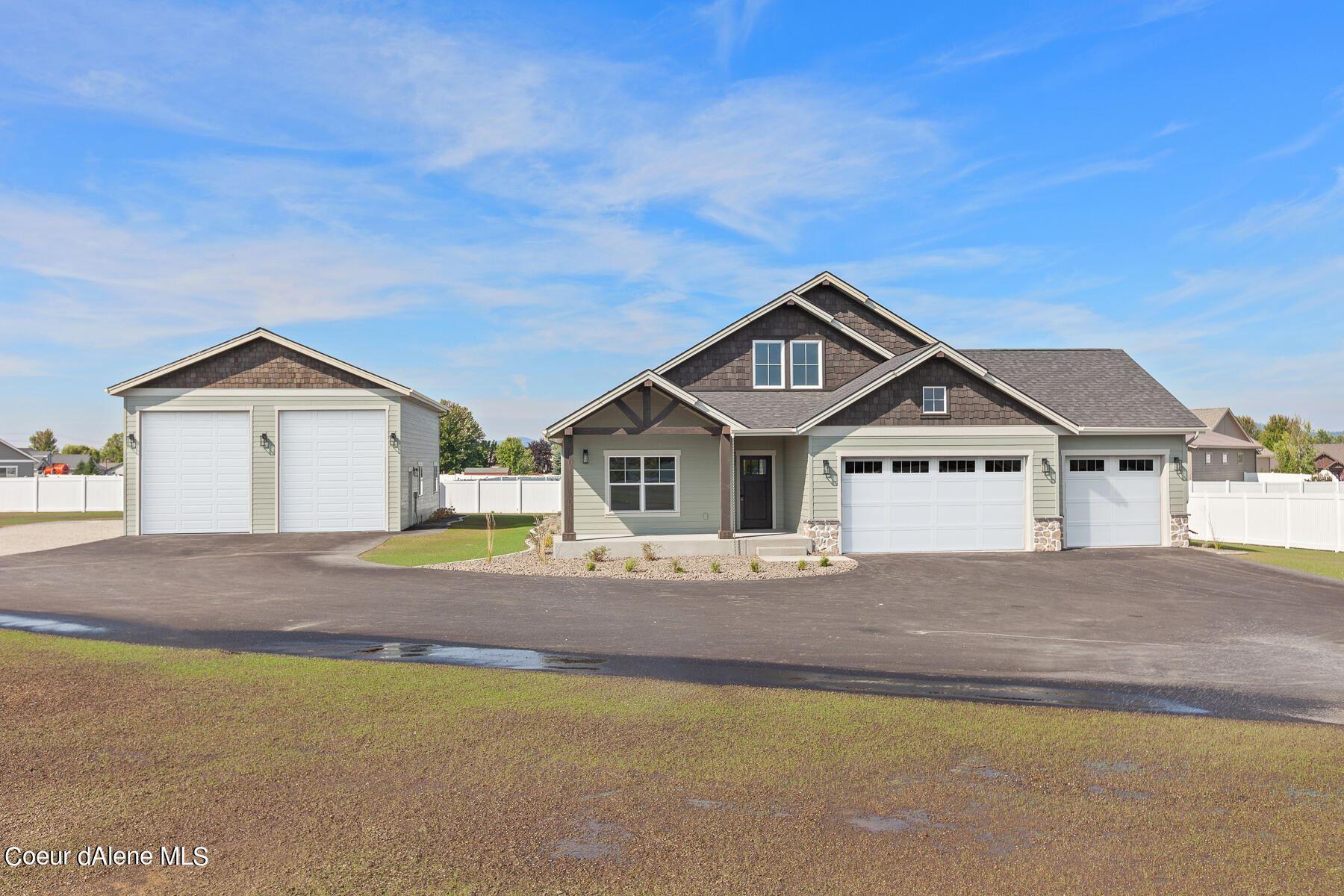 Photo of 1566 W Broadwater Ct, Post Falls, ID 83854 (MLS # 21-9418)