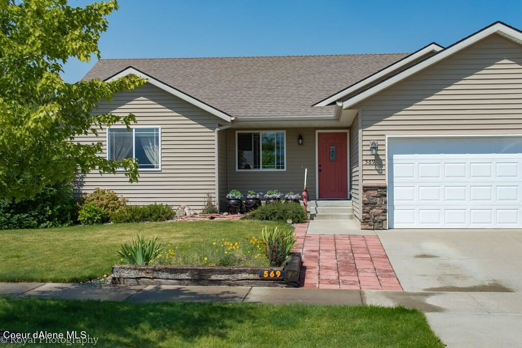Photo of 569 W Fisher Ave, Post Falls, ID 83854 (MLS # 21-7466)