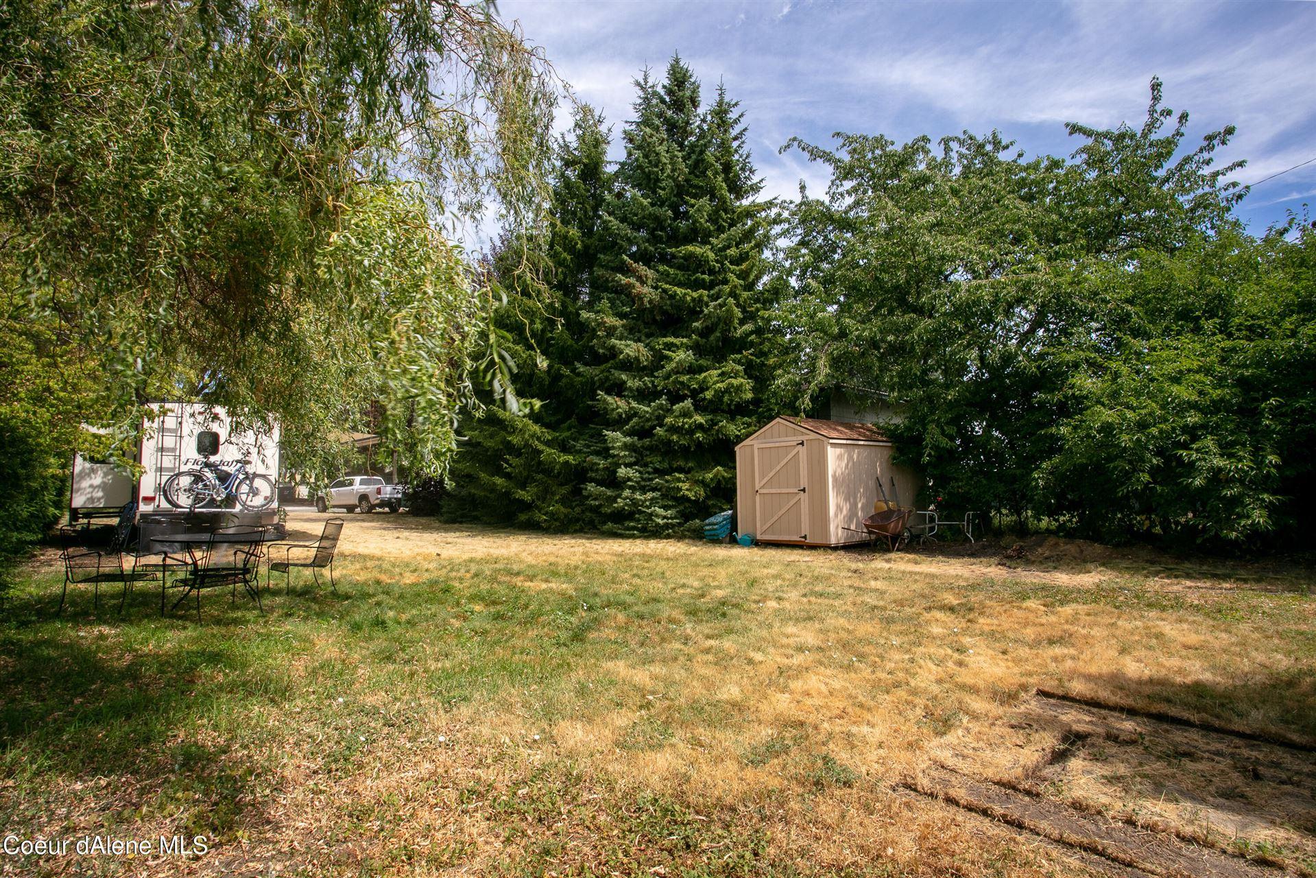Photo of 402 W Mill Ave, Coeur dAlene, ID 83814 (MLS # 21-7594)