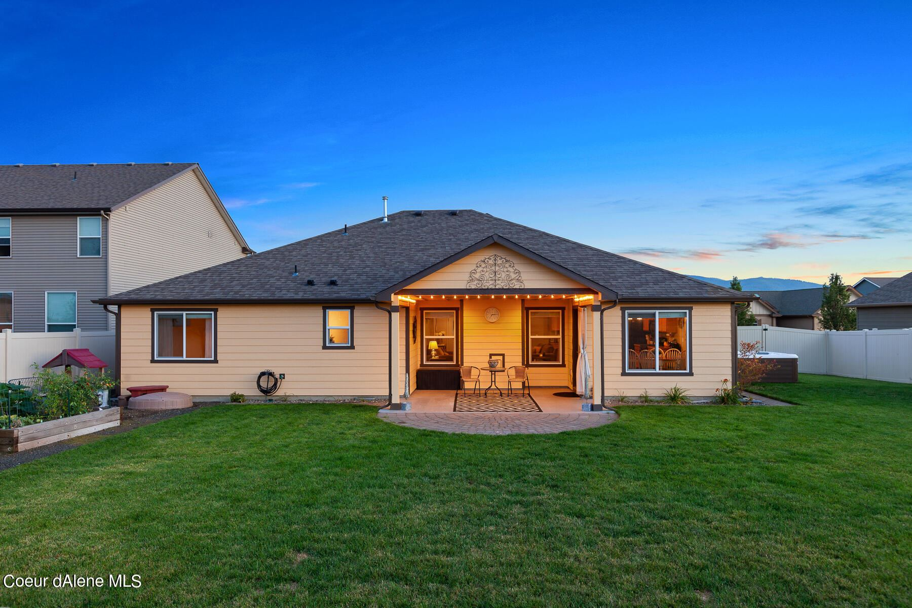 Photo of 1480 E WARM SPRINGS AVE, Post Falls, ID 83854 (MLS # 21-9594)