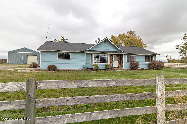 Photo of 5891 W HAYDEN AVE, Rathdrum, ID 83858 (MLS # 21-10614)