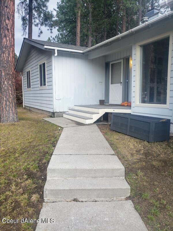 Photo of 409 S TIMBER LN, Post Falls, ID 83854 (MLS # 21-10660)