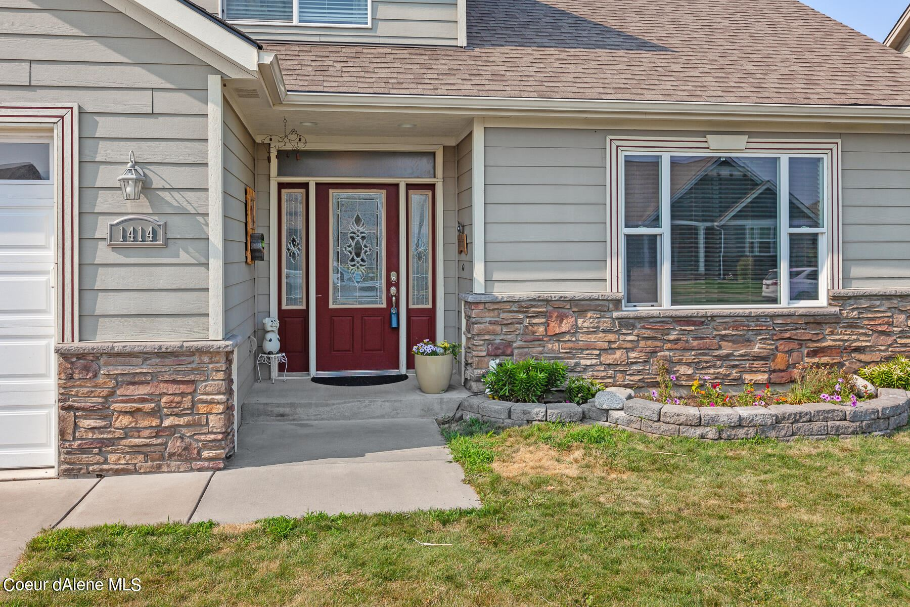 Photo of 1414 E WARM SPRINGS AVE, Post Falls, ID 83854 (MLS # 21-6835)