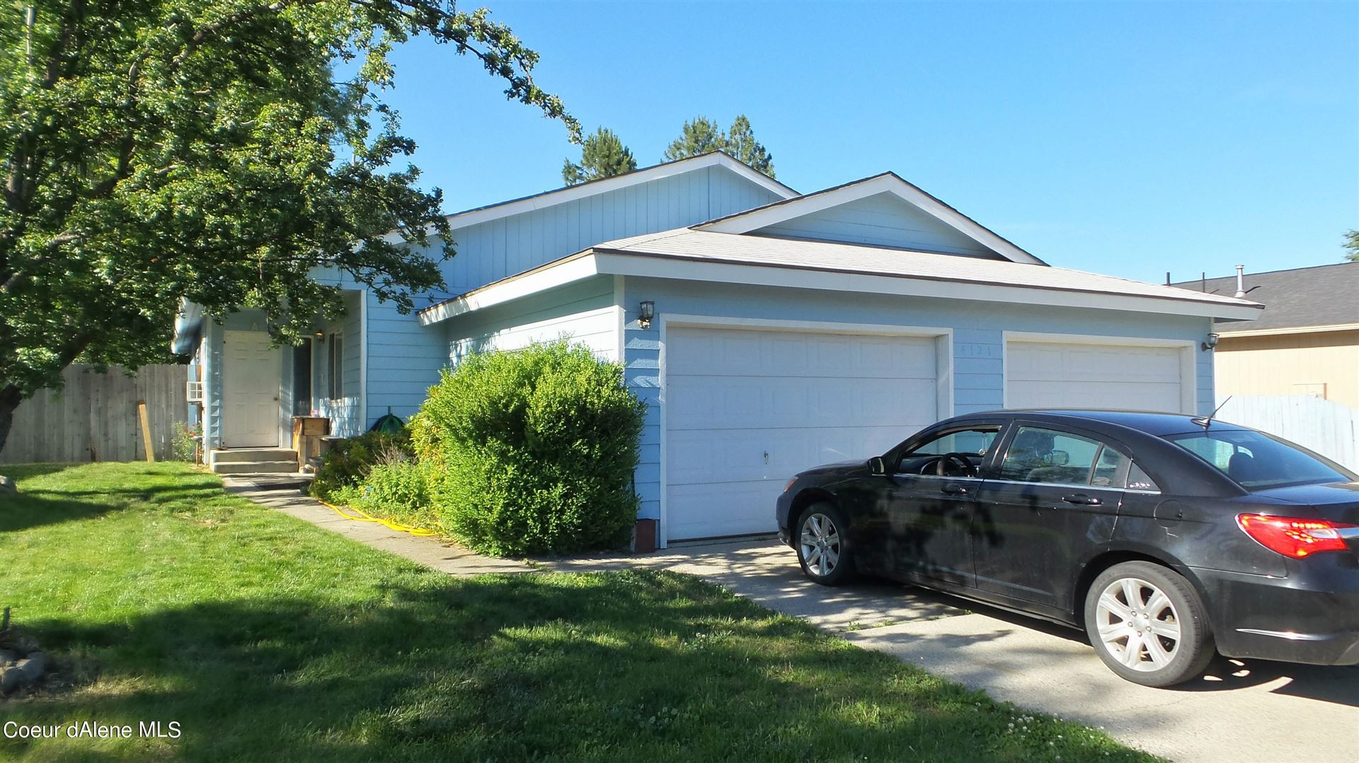 Photo of 4121 E 2ND AVE, Post Falls, ID 83854 (MLS # 21-5931)