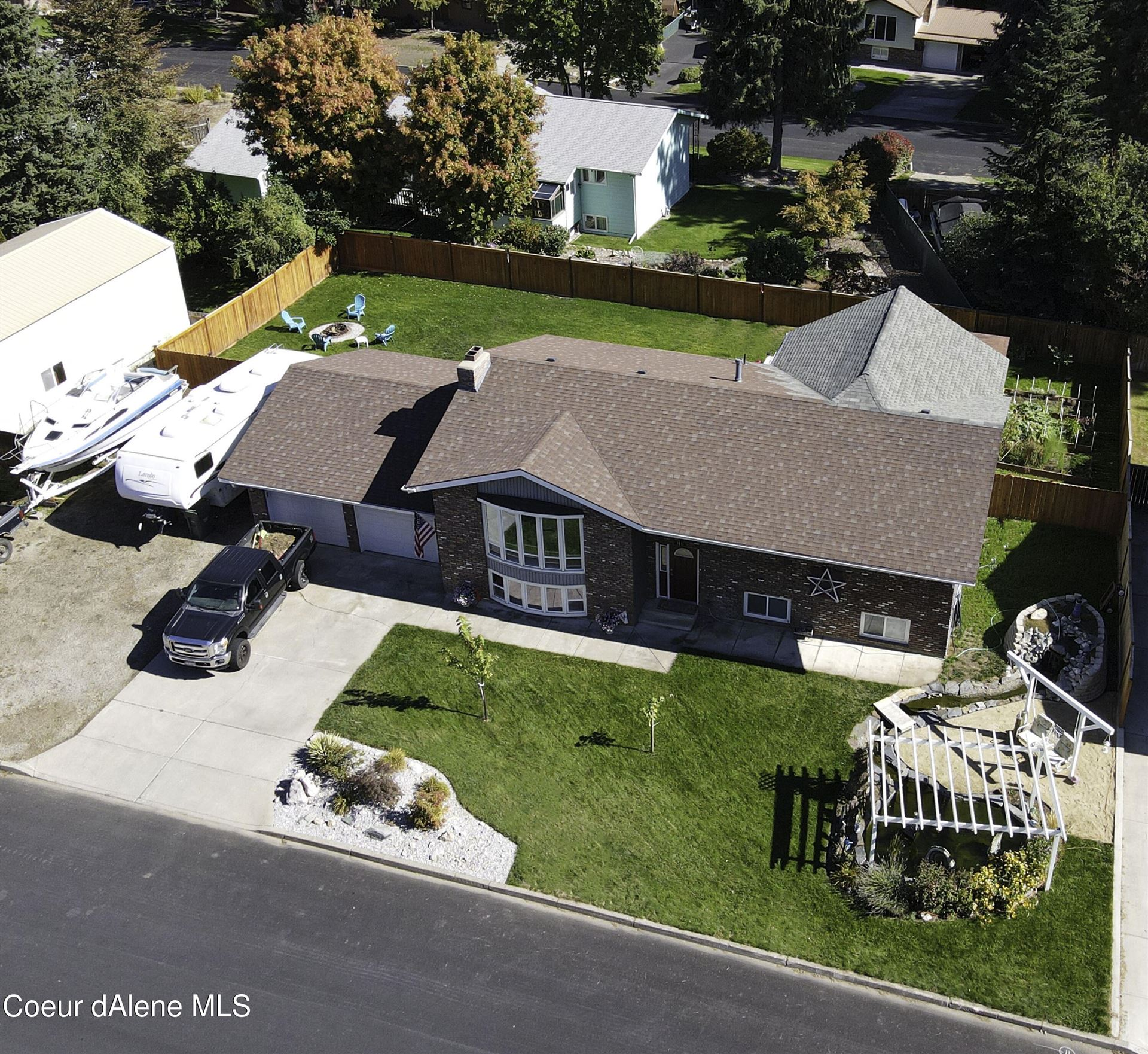 Photo of 311 S WESTWOOD DR, Post Falls, ID 83854 (MLS # 21-9971)