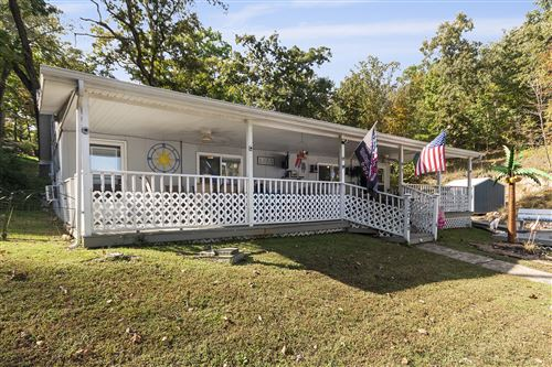 Photo of 5209 DEMPSEY DR, OSAGE BEACH, MO 65065 (MLS # 403276)
